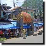 A large elephant getting ready to greet the god Ganesh