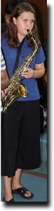 Alea warming up on the saxophone