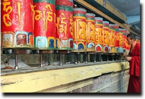 Monks spinning prayer wheels in Mcleod Ganj