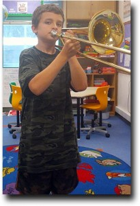 Breck playing his first notes on the trombone