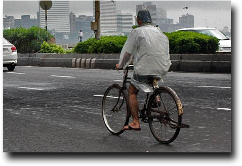 Riding a bike with the latest plastic raingear