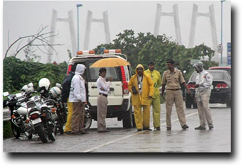 Policemen by the Sealink in slickers (unless you are a female, then you get an umbrella)