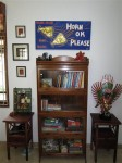 A bookcase we got in India, with a painting made by a friend there extolling the virtues of Mumbai's noise
