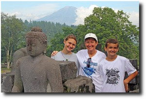 Three out of the four Stutz's pose with Buddha and the volcano