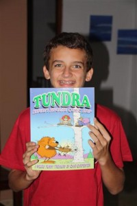 Breck with the Tundra comic book he got from his uncle and aunt