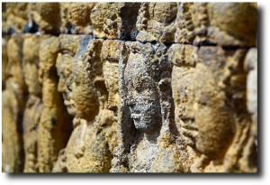Faces in the wall