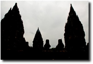 Prambanan's silhouette against the rain clouds