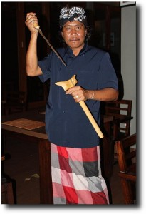 "Our neighborhood ""Pecalang,"" or Nyepi silentness enforcer, draws his knife with a fierce glare"