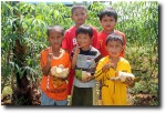 And here were the sons of our happy helpers, only too happy to get some coconuts themselves!
