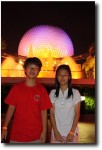 The JIS team in front of EPCOT at night