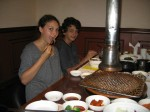 Alea and Breck seated at the cook-em-at-your-own-table Korean barbecue joint