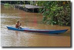 A local fisherman paddles across the river