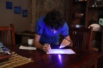 Breck tries out his new invisible ink pen.