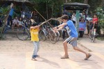 Breck swordfighting with local kids
