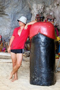 Category - Funny: A color-coordinated tourist poses with a giant phallic statue (lingam) in Phra Nang cave on Railay.