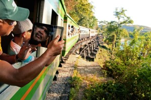 WINNER - Touristy: Taking pictures on the train crossing near Kanchanaburi, where the events of the Bridge on the River Kwai took place.