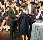 Mr. Carr (the head of school) confers the diploma