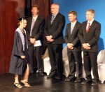 Alea goes on stage past the school board president, the dean of students, the head of school, and the high school principal.