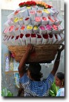 Flowers were being brought all over the market in various combinations, from basketfuls to headfuls, to hanging garlands