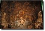 Three Buddhas facing each other