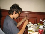 """Breck demonstrates his """"mastery"""" of chopsticks"""