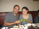Dave and Alea wrap up their kalbi in leaves, complete with garlic, spicy sauces, and all sorts of herbal toppings