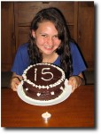 Alea shows off her cake (and lonely candle)