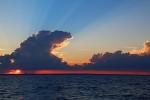 Sunset through a rainstorm on Lake Michigan