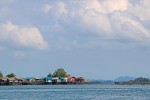 Between the water and the sky, fishing villages a built on stilts due to the varying tidal levels.