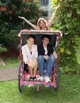 In a bike rickshaw (called a becak)