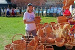 Susan checks out the baskets for sale.